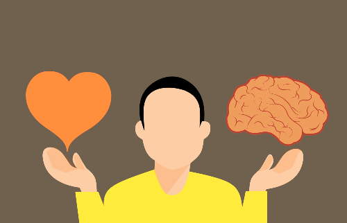 man holding a heart and a brain in his hands