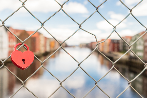 a fence with a heart locker