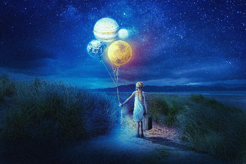 girl holding a suitcase and balloons
